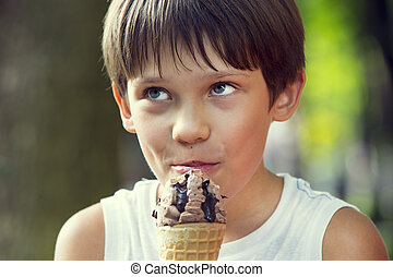 little boy eating an ice cream dessert