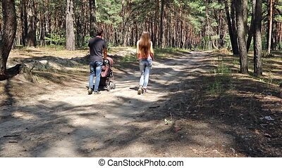Couple walking with stroller - Man carries baby carriage...