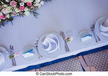 Flower arrangement on the table. Flowers and white...