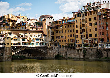 Ponte Vecchio over Arno river in Florence, Italy .