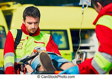 Emergency medical service - Team of rescuers paramedic and...
