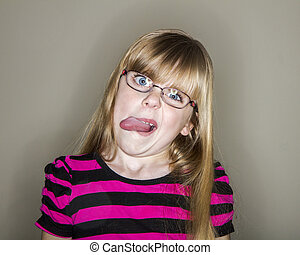 young girl sticking out her tounge - tongue hanging out a...