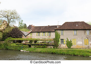 Houses at the river the Auvezere - River the Auvezere with...