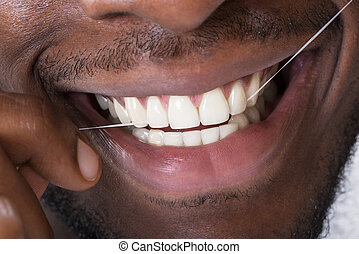 Close-up Of An Man Cleaning His Teeth