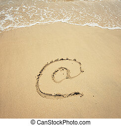 Email symbol draw on beach