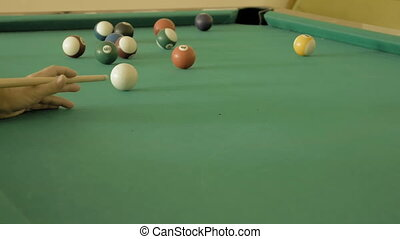 Close up of man playing pool billiard, snooker Player...