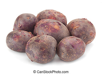 Young purple potatoes - Young raw purple potatoes isolated...