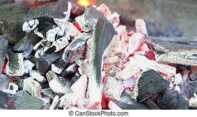 Burning charcoal with orange-colore