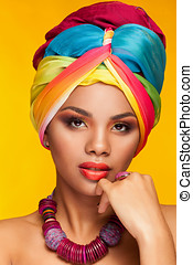 Woman in ethnical afro american turban - Young woman in...