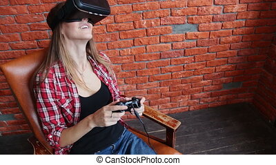 Woman playing with Virtual Reality Glasses in home.