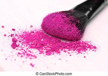 make-up brush on pink crushed eyeshadow