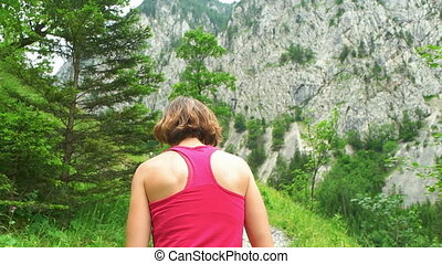 Woman on the Walk Next to the Mountain - Young female...