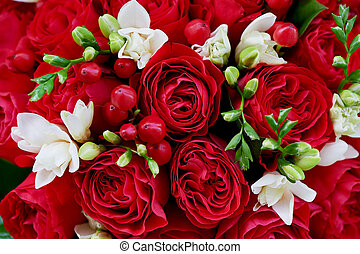 dense red bouquet of roses, with berries and Close texture -...