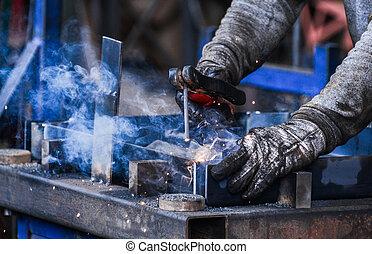 Arc welding of a steel in factory