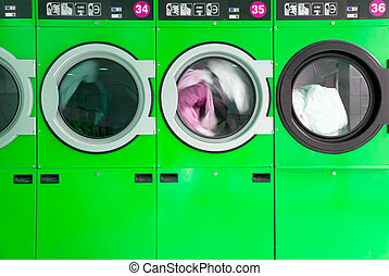 clothes washers - green clothes washers in a laundrette
