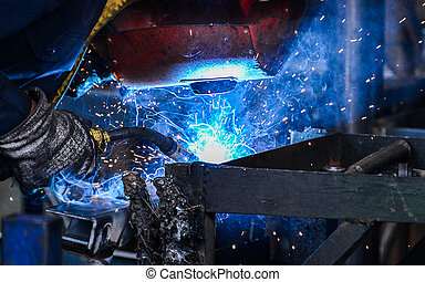 Arc welding of a steel in factory