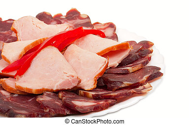 Sliced homemade dry sausages and meat products, cured meat,...