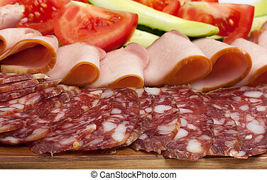 Sliced dry sausages and meat products, cured meat, bacon,...