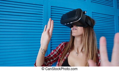 happy young woman with virtual reality headset - technology,...