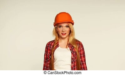 Girl and hands with building tools - Cheerful girl builder...