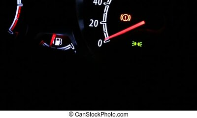 Car instrument panel illuminated at night