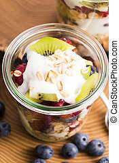 musli served with joghurt and fresh fruits - musli served...