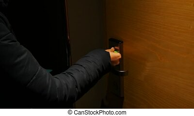 woman open hotel door with card key and come in