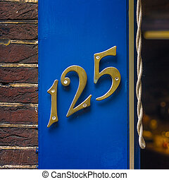 Number 125 - Brass house number one hundred and twenty five