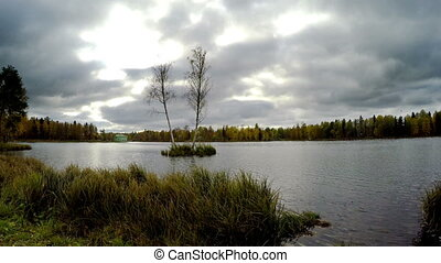cloudy autumn day over the lake. Russia. - cloudy autumn day...