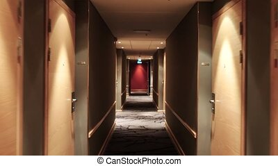 Moving through a hotel corridor, stedicam shot