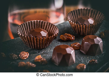 Chocolate praline on black background