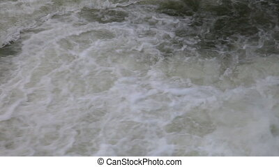 The flow of river water - Bubble a stream of mountain river...