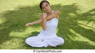 Pretty single woman in empty yard stretching arms - Pretty...