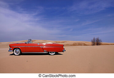 Classic red car in the middle of desert