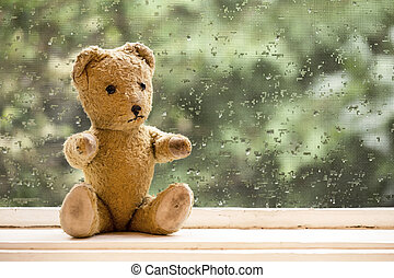 Vintage toy bear - Cute old vintage toy bear sitting in the...
