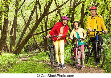 Girl with parents walking mounting biking trail - Teenage...