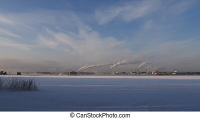 emissions of industrial enterprises in the frosty winter day.