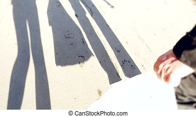 Shadow of couple go out of the store with bags. Shopping...