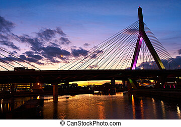 Zakim Bunker Hill Memorial Bridge at sunset in Boston,...