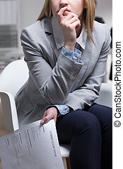 On paper it looked all right - Female job applicant holding...