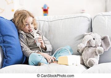 Difficult day for an asthmatic child - Little boy with...