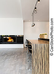 Warming the ascetic interior up with a large fireplace