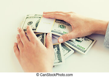 close up of woman hands counting us dollar money - business,...