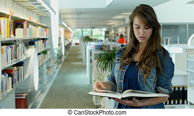 A young woman in a public library Its her leisure time and...