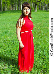 girl in the red and the green green grass.