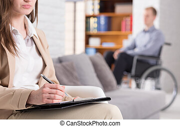 Professioncal post-traumatic center - Woman making notes...