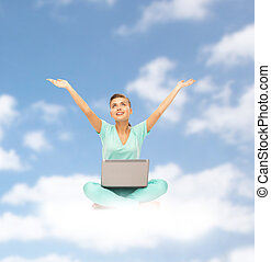 happy young woman with laptop sitting on cloud - people,...