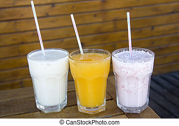 three non-alcoholic beverages - three soft drinks in a...
