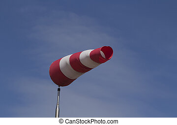 Windsock against a blue sky - Close up landscape color photo...
