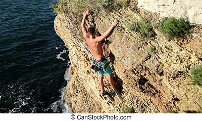 Extreme Climber Climbing On A Rock